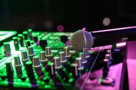Photo for Close up view of sound mixer with microphone in nightclub - Royalty Free Image