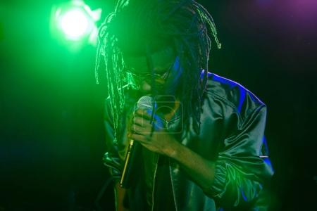 african american DJ with microphone
