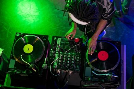 DJ in headphones with sound mixer