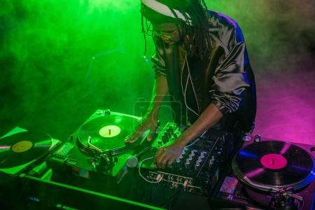 club DJ with sound mixer