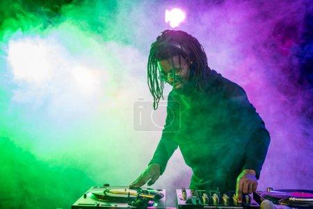 professional DJ in headphones with sound mixer
