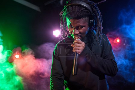DJ in headphones with microphone