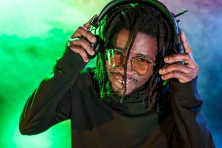DJ in headphones and sunglasses