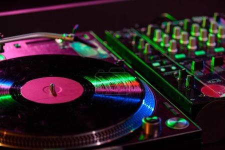 Photo for Close up view of sound mixer with vinyl in nightclub - Royalty Free Image