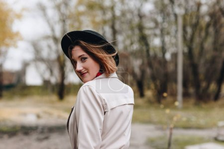 woman walking by autumn park