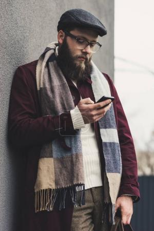man using smartphone