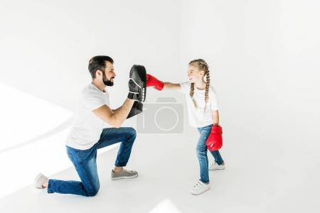 father and daughter boxing together