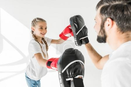 Photo for Side view of happy father and daughter boxing together on white - Royalty Free Image