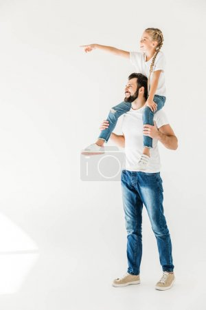 Photo for Happy father carrying adorable little daughter on shoulders isolated on white - Royalty Free Image