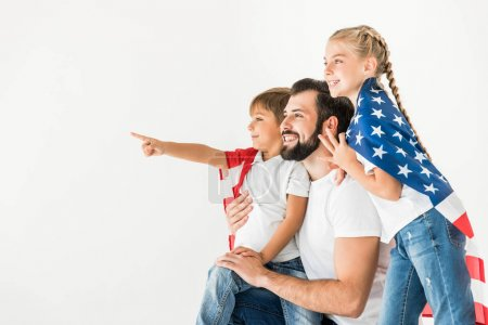 Photo for Happy father and kids with american flag looking away isolated on white - Royalty Free Image