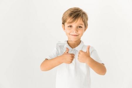 Foto de Lindo muchachito mostrando los pulgares para arriba y sonriendo a cámara aislada en blanco - Imagen libre de derechos
