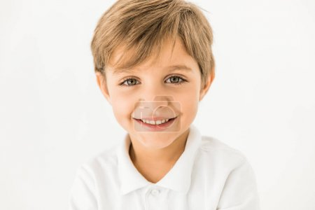 Close-up portrait of adorable happy little boy smi...