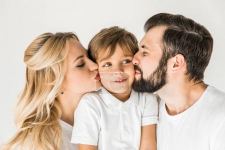 parents kissing son