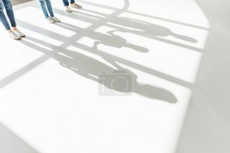 legs of family and shadows