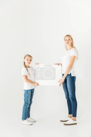 mother and daughter with blank card