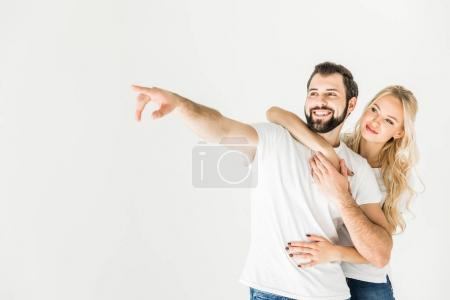 couple pointing away with finger