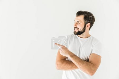 Photo for Handsome smiling bearded man pointing away with finger isolated on white - Royalty Free Image