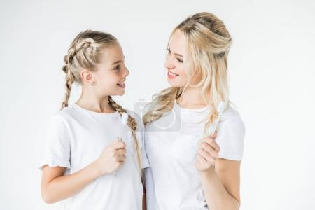 mother and daughter with toothbrushes