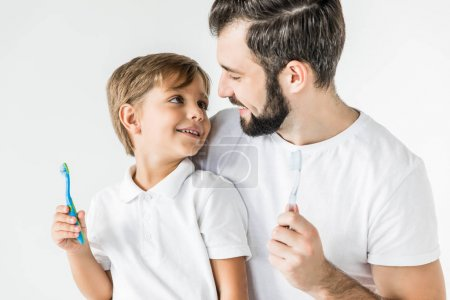 father and son with toothbrushes
