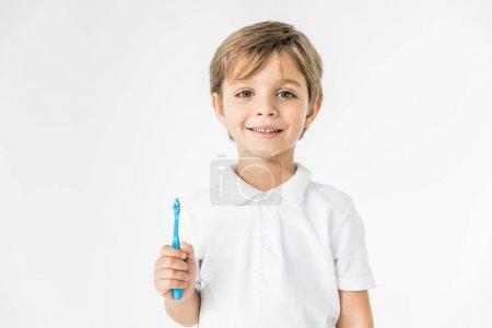 boy holding toothbrush