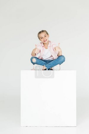 child showing thumbs up