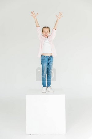Photo for Adorable little girl raising hands and smiling at camera isolated on white - Royalty Free Image