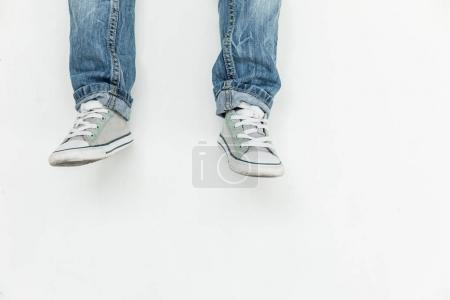 child in jeans and shoes