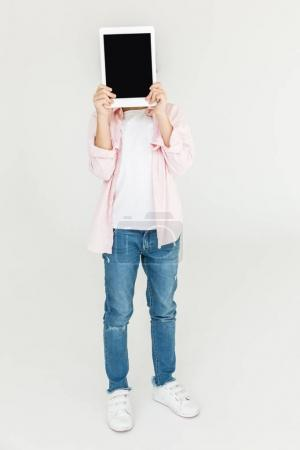 child holding digital tablet