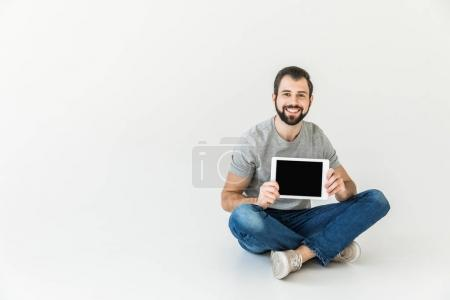 Photo for Cheerful young man holding digital tablet with blank screen and smiling at camera isolated on white - Royalty Free Image