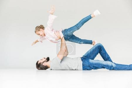 Photo for Beautiful happy father and daughter having fun together isolated on white - Royalty Free Image