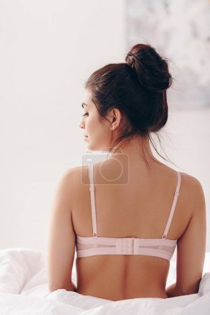 woman in lingerie posing in bed