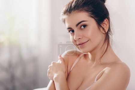 Photo for Portrait of beautiful smiling girl in lingerie looking at camera - Royalty Free Image
