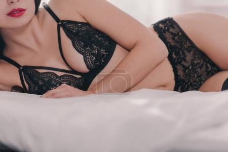 Cropped view of seductive girl in black sexy linge...