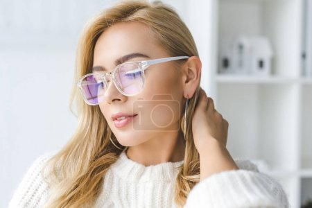 fashionable woman in eyeglasses