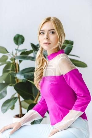 stylish woman in pink blouse