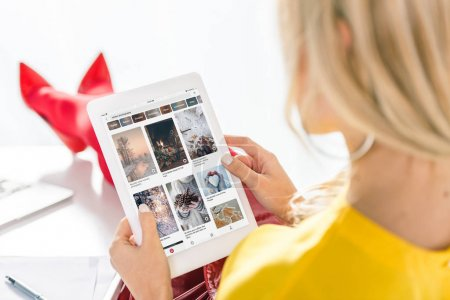 woman using tablet with pinterest