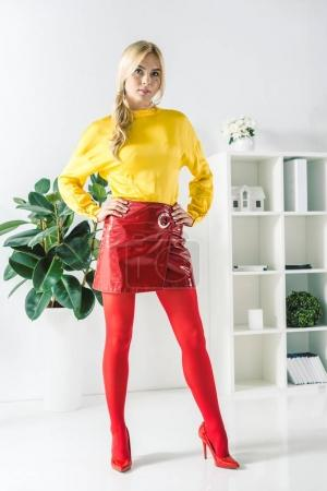 fashionable businesswoman in red skirt