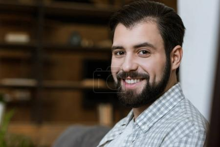 young smiling attractive man with beard looking at camera