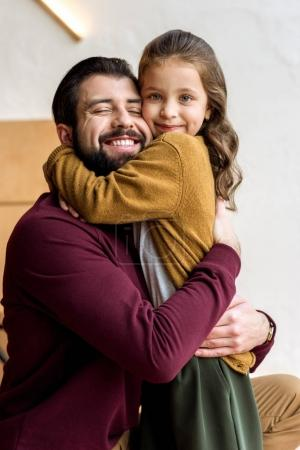 happy father and daughter hugging each other