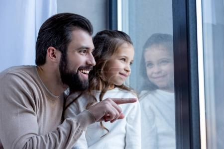Photo for Happy father pointing on something and looking away - Royalty Free Image