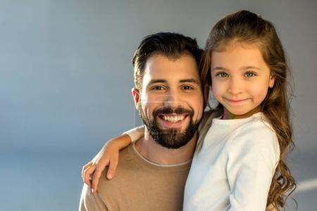 Photo for Portrait of happy father and daughter looking at camera - Royalty Free Image