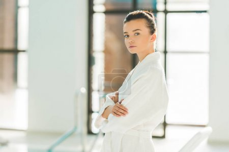 beautiful young woman in bathrobe relaxing at spa
