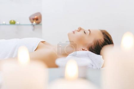 Photo for Beautiful woman relaxing on massage table at spa salon - Royalty Free Image