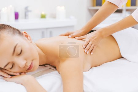 Photo for Relaxed young woman having massage at spa - Royalty Free Image