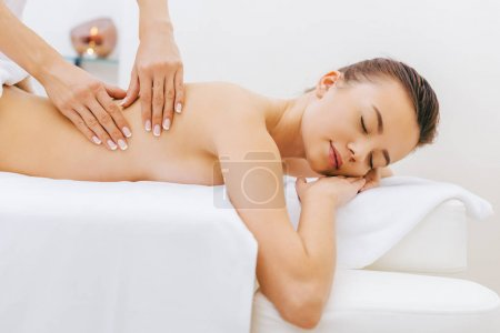 attractive young woman having massage at spa