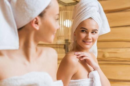 close-up shot of beautiful young women in sauna