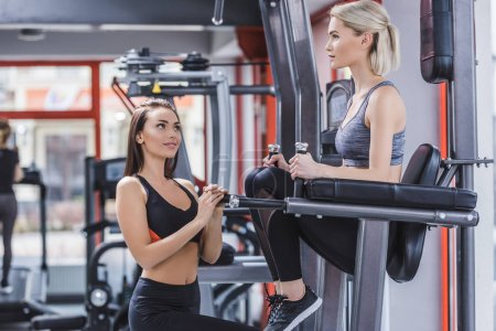 young athletic women working out at gym