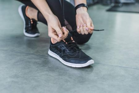 Photo for Cropped shot of woman lacing up sneakers before training - Royalty Free Image