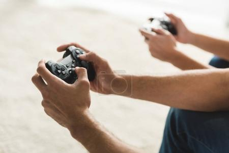 Photo for Cropped shot of couple playing computer games with gamepads - Royalty Free Image