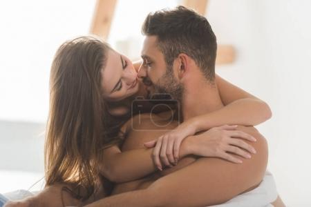 beautiful young woman embracing boyfriend